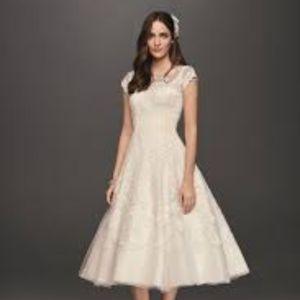09c120fcba7c Oleg Cassini Dresses - Oleg Cassini CMK513 Ivory Tea Length Wedding Gown